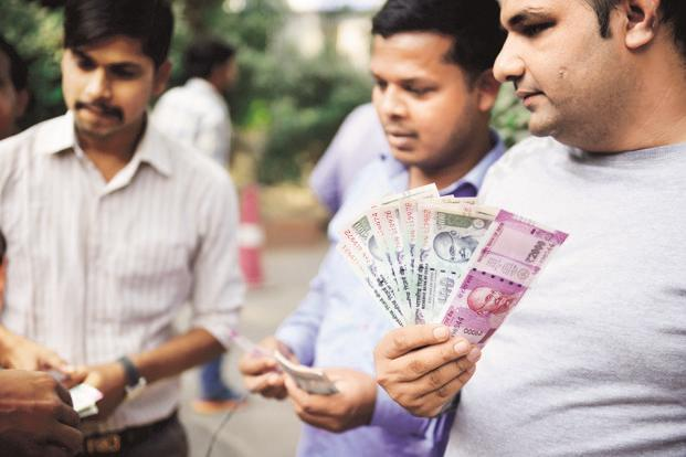 Banks have spent months dealing with the fallout of Prime Minister Narendra Modi's decision to withdraw 86% of India's currency. There still aren't enough currency notes in ATMs, as a senior finance ministry official admitted recently. Photo: Mint
