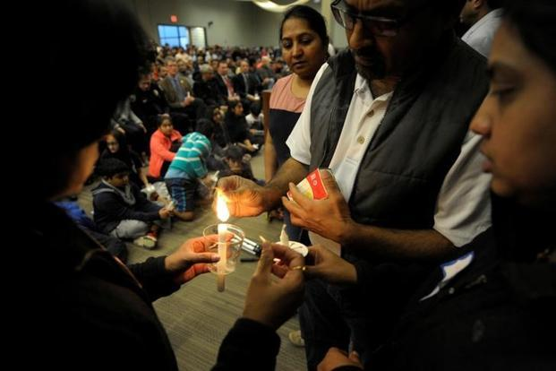 People light candle during a vigil for Srinivas Kuchibhotla, an Indian engineer who was shot and killed, at a conference center in Olathe, Kansas on Sunday.  Photo: Reuters