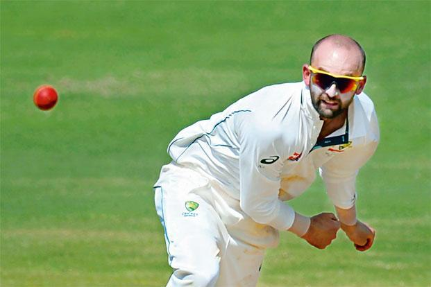 Nathan Lyon's five helped Australia beat India in the first Test in Pune. Photo: AFP