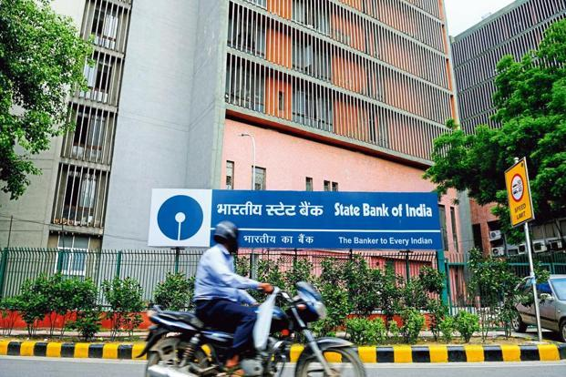 With the merger of all the five associates, SBI is expected to become a lender of global proportions with an asset base of Rs37 trillion, 22500 branches and 58,000 ATMs. Photo: Pradeep Gaur/Mint.