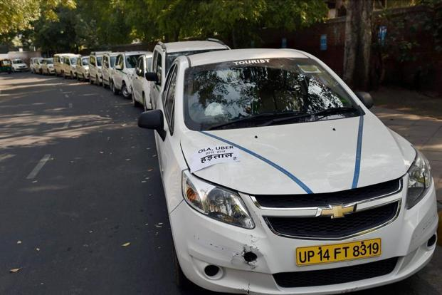 Over the last few weeks, there have been agitations by drivers of both Ola and Uber, particularly on issues like fall in earnings and incentives offered to them. Photo: PTI