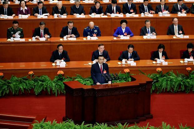 China's Premier Li Keqiang delivers a government work report as delegates listen during the opening session of the National People's Congress (NPC) at the Great Hall of the People in Beijing, China, on Sunday. Photo: Reuters