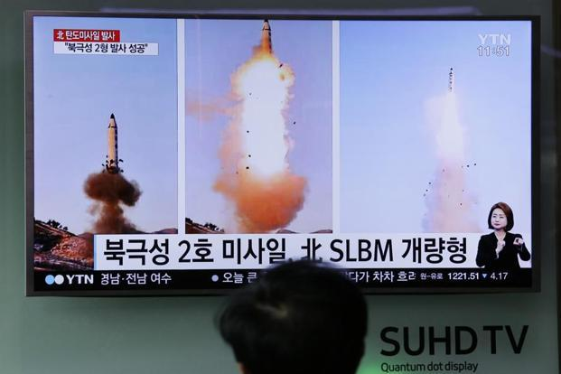 A man watches a TV news programme showing photos published in North Korea's Rodong Sinmun newspaper of North Korea's 'Pukguksong-2' missile launch at Seoul Railway station in Seoul, South Korea. File photo: AP