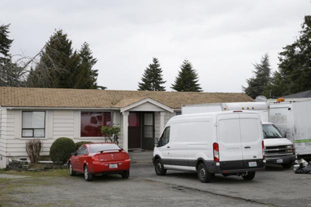 Vehicles sit parked on Sunday at the home and driveway where a Sikh man was shot in the arm Friday in Kent, Washington. Photo: AP
