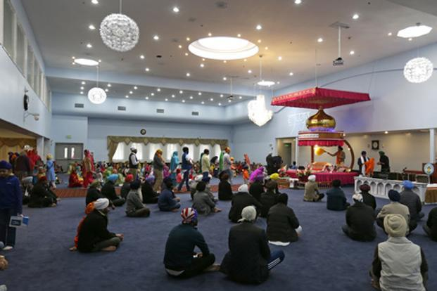Men and women attend Sunday services at a Sikh temple in Renton, Washington, on Sunday. Photo: AP