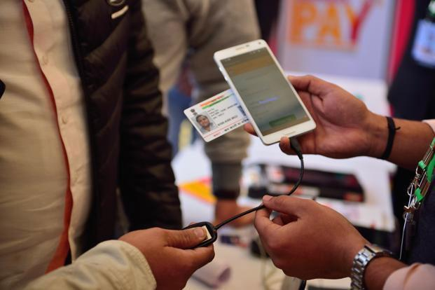 Aadhaar Pay is a service for merchants which will enable them to receive payments from customers without any physical payment instrument. Photo: Mint