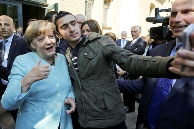 A file photo of Syrian refugee Anas Modamani taking a selfie with German Chancellor Angela Merkel outside a refugee camp near the Federal Office for Migration and Refugees. Photo: Reuters