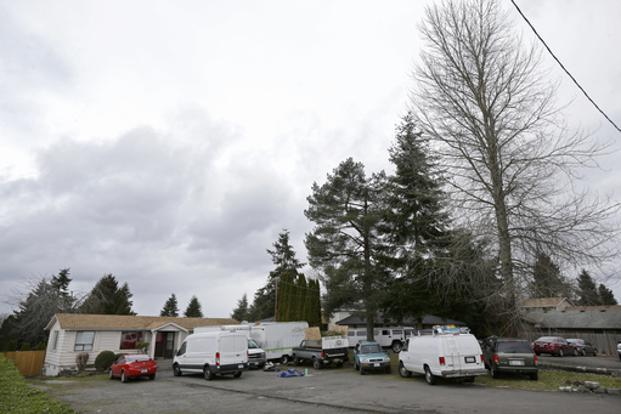 Vehicles are parked on Sunday at the home and driveway where Deep Rai was shot in the arm Friday, in Kent, Washington. Photo: AP