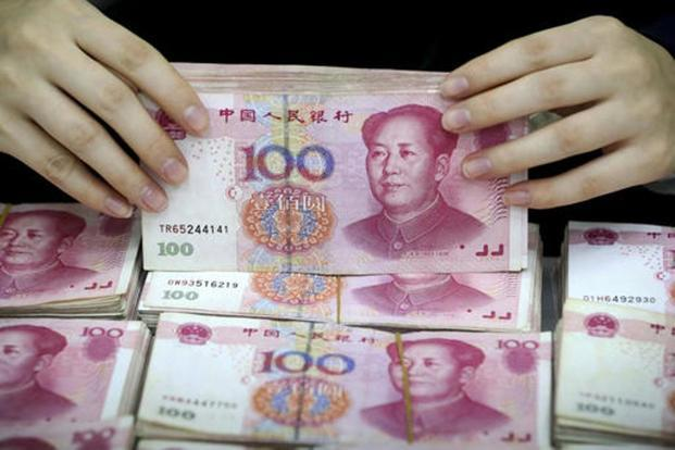 The reserves—still the world's largest—have shrunk from a peak of $4 trillion in 2014 as policy makers sold dollars to slow yuan depreciation. Photo: AP