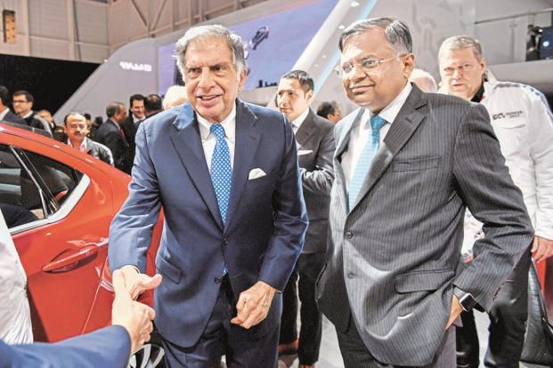 Tata Sons chairman emeritus Ratan Tata and chairman N. Chandrasekaran at the Geneva Motor Show. A MoU was signed by Tata Motors CEO Guenter Butschek and Volskwagen CEO Matthias Muller on Wednesday. Photo: AFP