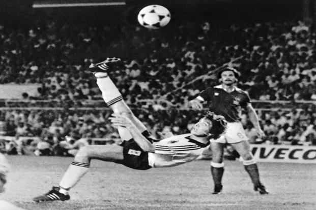 In this 8 July 1982 file photo, West Germany's Klaus Fischer scores the third goal and equalizes, in the World Cup semi-final soccer match against France, in Seville, Spain. West Germany won in a penalty shoot-out after coming back from 3-1 down in extra time to draw 3-3. Photo: AP