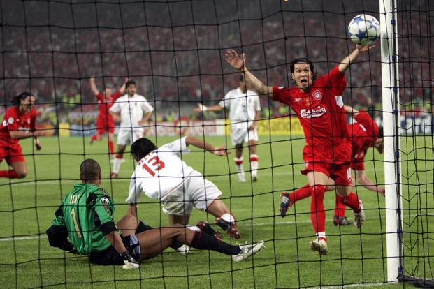 In this 25 May 2005 file photo, Liverpool's Luis Garcia, right, celebrates after his teammate Xabi Alonso, behind him at right, scored his team's 3rd goal, during the Champions League Final between AC Milan and Liverpool at the Ataturk Olympic Stadium in Istanbul, Turkey. 3-0 down at half-time, Liverpool came back to force a penalty shoot-out that it won. Photo: AP