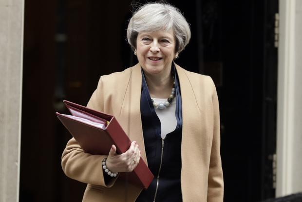 With British PM Theresa May intent on taking the UK out of the single market, access for London firms will probably be contingent on British rules remaining equivalent to those in the EU, and that judgment will be made in Brussels. Photo: AP