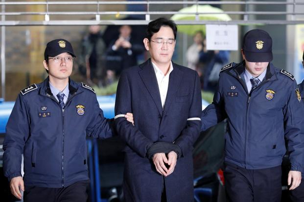Samsung group's Jay Y. Lee (centre) has been charged with bribery in a corruption scandal that has led to the impeachment of President Park Geun-hye. Photo: Reuters