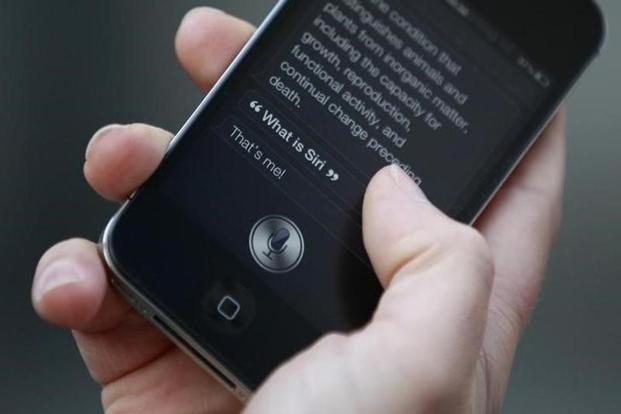 A user making demonstration of Siri, an application which uses voice recognition and detection on the iPhone 4S. Photo: Reuters