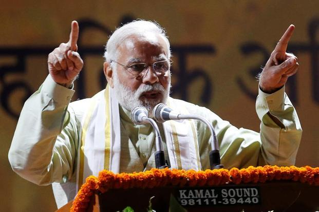 """BJP massive election victory has forced political pundits to introspect"", says Modi in his address to party workers at the BJP headquarters in New Delhi."