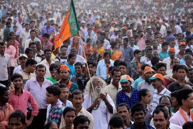 A file photo of a BJP rally. Besides the obvious advantage of now being in a position to significantly strengthen its base in the Rajya Sabha, BJP no longer needs to curb its reformist agenda in the fear the electorate may not accept it. Photo: AFP