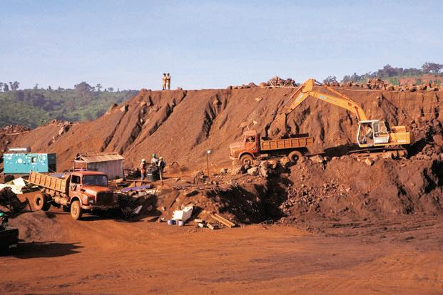 A file photo of trucks loaded with iron ore at a iron ore mine in Orissa. Photo: Bloomberg News