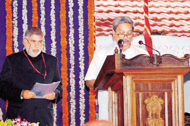Manohar Parrikar (right) takes oath as Goa chief minister at a swearing-in ceremony in Panaji on Tuesday. Photo: Mint