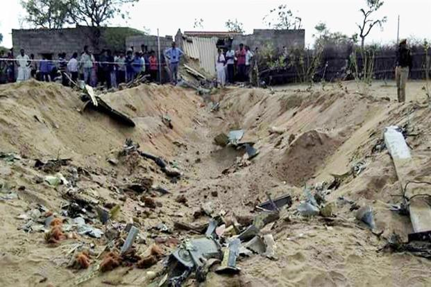 People gather near the site in Shivkar Kudla village where an IAF Sukhoi-30 MKI fighter aircraft crashed while on a routine training sortie in Barmer district of Rajasthan on Wednesday. Photo: PTI
