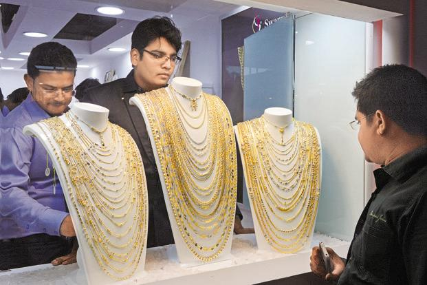 Slack demand from local jewellers, along with a weak trend overseas, fed the subdued activity that led to fall in gold prices. Photo: AFP