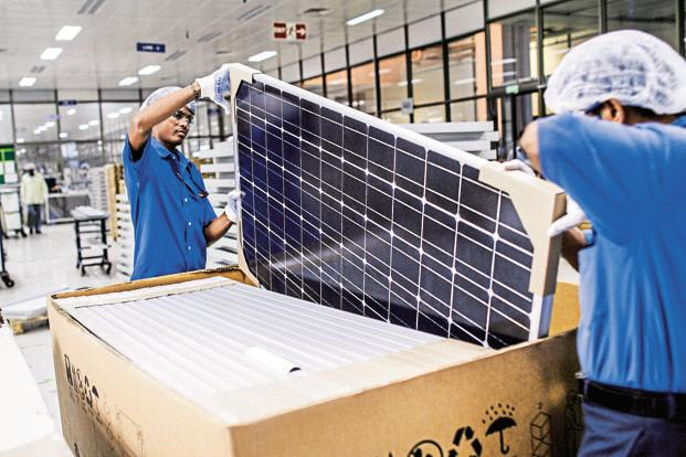 Prices of solar modules, which make for nearly 60% of a solar project's total cost, fell by about 26% in 2016. Solar power tariffs in India, meanwhile, have plunged to Rs2.97 kWh. Photo: Bloomberg