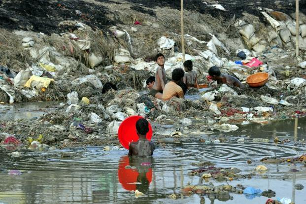 Ragpickers search for coins, gold in the polluted waters of the Ganga river at Sangam after the Kumbh Mela festival, in Allahabad in April 2013. Photo: AFP