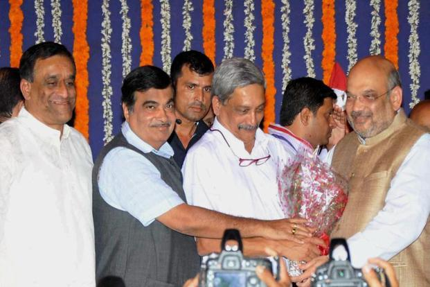 Newly sworn-in Goa chief minister Manohar Parrikar being greeted by BJP president Amit Shah and Union minister Nitin Gadkari in Panaji. Photo: PTI