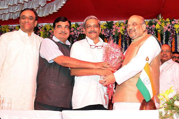 Manohar Parikar, centre, attends took the oath of office as the chief minister of Goa on Tuesday. BJP president Amit Shah, right, attended the swearing-in ceremony. Parrikar has played key role in making the saffron party a force to reckon with in Goa, which remained for long a Congress bastion, with regional outfits having pockets of influence. Photo: AFP