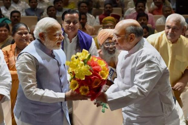 Prime Minister Narendra Modi (left) and BJP president Amit Shah at the BJP parliamentary party meeting on Thursday. Shah said BJP should aim to return to the Lok Sabha with a bigger mandate than in 2014. Photo: PTI