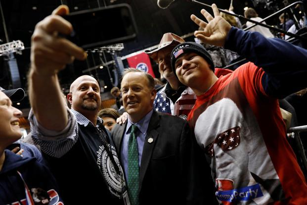White House press secretary Sean Spicer (centre) poses for a photo with supporters of US President Donald Trump during a rally at Municipal Auditorium in Nashville on Wednesday. Photo: Reuters