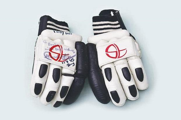 Autographed gloves used by Sachin Tendulkar while scoring his 100th century.