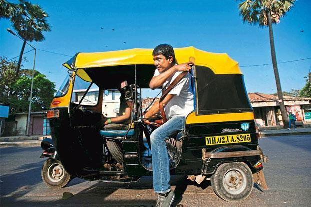 Adil Hussain takes a rickshaw before a meeting.