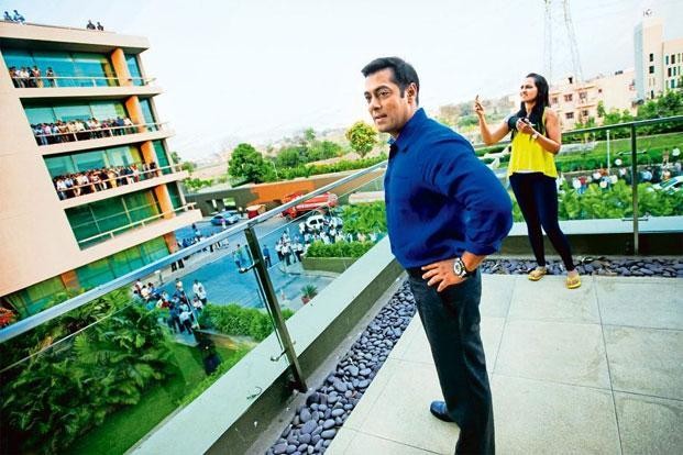 Crowds gather in a private compound in Pune to see Salman Khan.