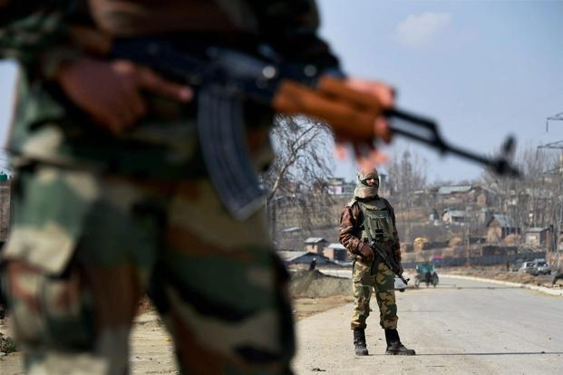 File photo. Army soldiers stand guard at Srinagar-Jammu national highway in Pulwama district. Photo: PTI