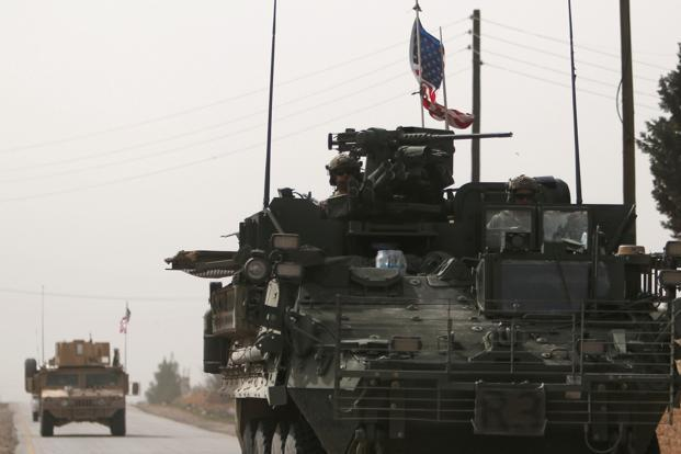 File photo. American army vehicles drive north of Manbij city in Aleppo, Syria, on 9 March 2017. Photo: Reuters