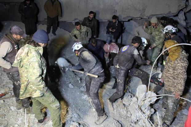 Syrian civil defence volunteers dig through the rubble of a mosque following a reported airstrike on a mosque in the village of Al-Jineh in Aleppo province on Thursday. Photo: AFP