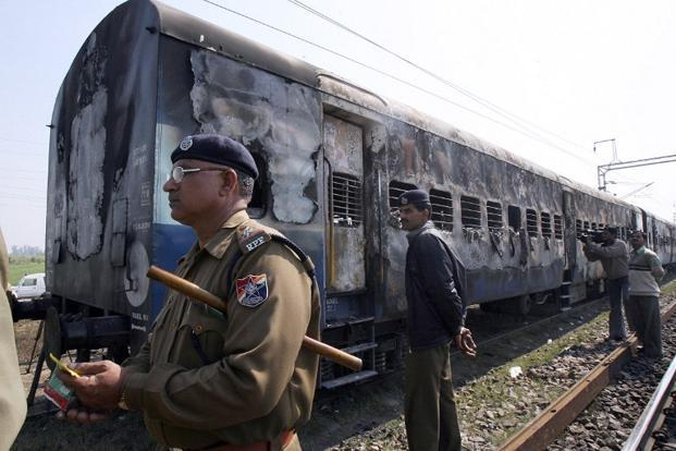 A file photo of charred carriages of 'Samjhauta Express' in which 68 people were killed after a blast near Panipat in 2007. Photo: AFP