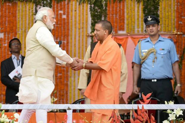 Prime Minister Narendra Modi with Uttar Pradesh chief minister Yogi Adityanath during the latter's swearing-in ceremony in Lucknow on Sunday. Photo: PTI