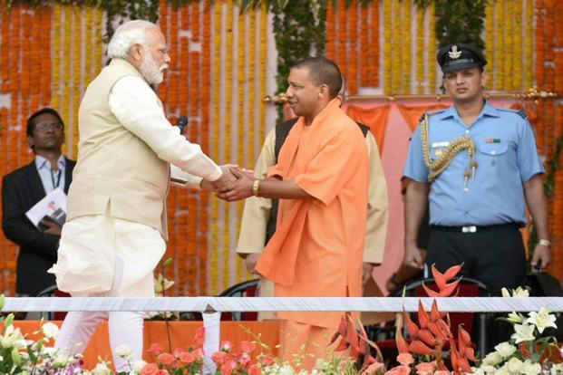 Liberals seem to be strangely upset that no sooner did Narendra Modi (left) win UP elections on the development card, he went ahead and discarded it for a Hindutva one by naming Yogi Adityanath as chief minister of Uttar Pradesh. Photo: PTI