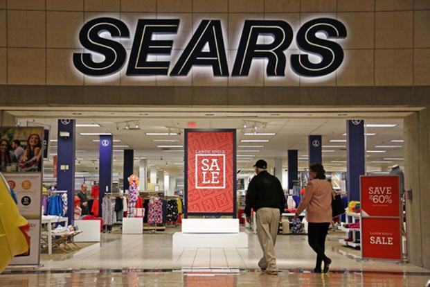 Shoppers walk into a Sears store in Pittsburgh.  Photo: AP