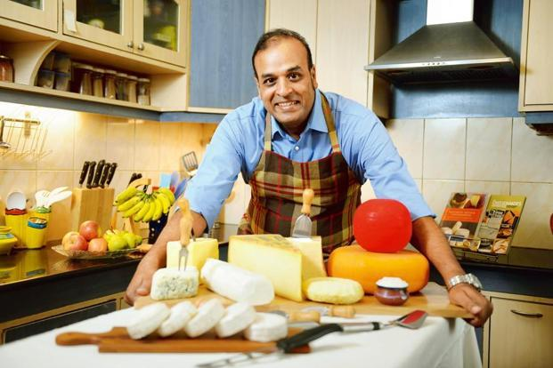 Mukund Naidu with his collection of cheese. Photo: Hemant Mishra/Mint