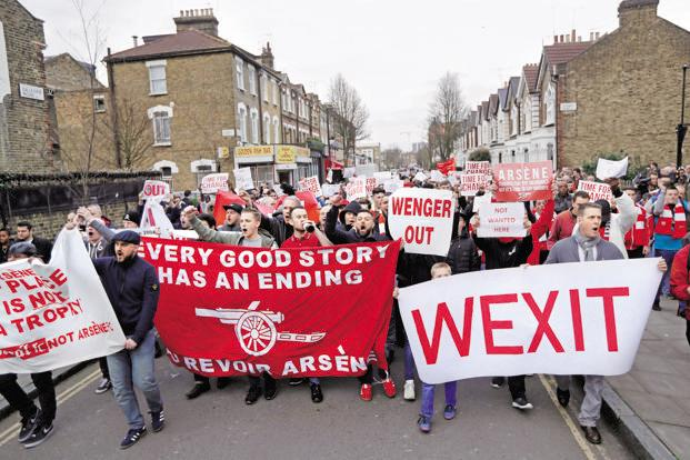 Arsenal fans calling for the resignation of manager Arsène Wenger ahead of their English FA Cup quarter-final soccer match against Lincoln City at the Emirates stadium in London, on 11 March. Photo: Reuters