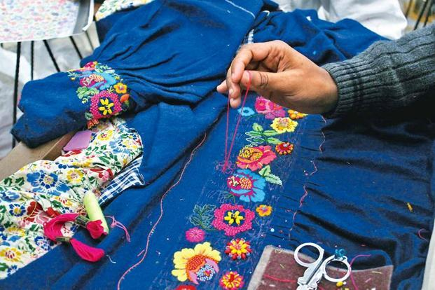 Hand-embroidery being done at Arora's Delhi workshop.