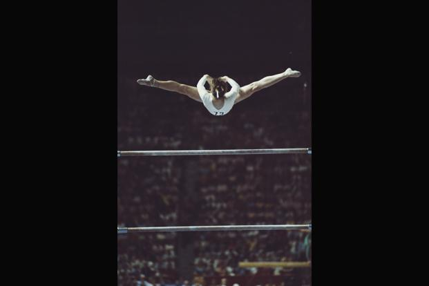 A file photo of Nadia Comăneci in action during competition on the uneven bars at the 1976 Montreal Olympics. Photo: Getty Images