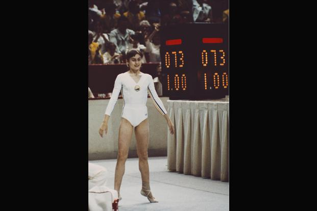 Comaneci after scoring a perfect 10 on the uneven bars routine on 18 July. Photo: Don Morley/Getty Images