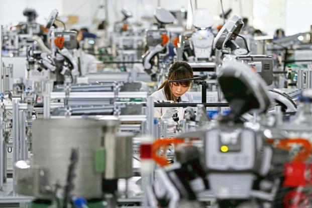 Automation through robot workers and software is the new normal in sectors like engineering, manufacturing, automobiles, IT and banking. Photo: Reuters