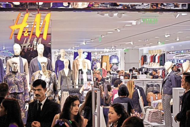 Hennes & Mauritz (H&M) gets about 80% of its products from Asia, where the dollar's strength has inflated the cost of purchases of garments, as many currencies in the region are linked to the currency. Photo: Pradeep Gaur/Mint