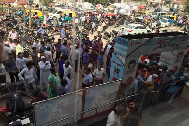 People wait outside a Hero MotoCorp dealership in Jaipur  that has sold out its inventory of BS-III vehicles. Photo: Mint