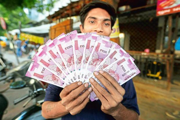 RBI has already introduced new Rs 2,000 and Rs 500 banknotes. Photo: AP